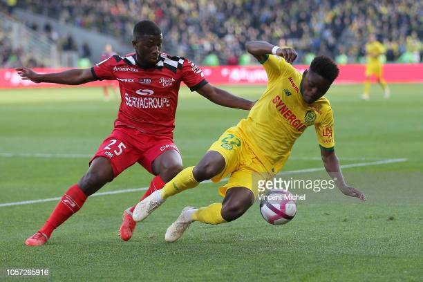 Anthony Limbombe of Nantes and Cheik Omar Traore of Guingamp during the Ligue 1 match between Nantes and Guingamp at Stade de la Beaujoire on...
