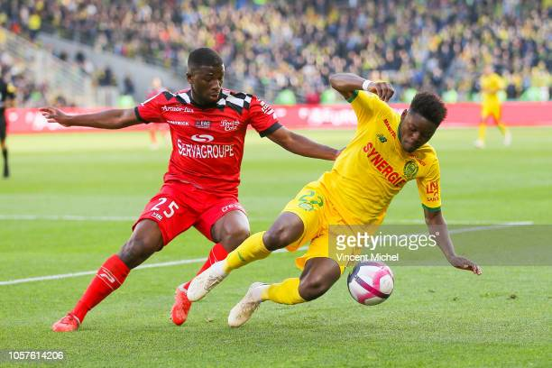 Anthony Limbombe of Nantes and CheikOmar Traore of Guingamp during the Ligue 1 match between Nantes and Guingamp at Stade de la Beaujoire on November...
