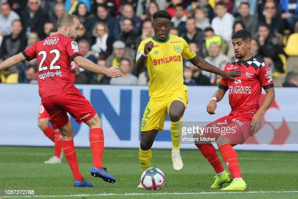 Anthony Limbombe of Nantes and Etienne Didot and Ludovic Blas of Guingamp during the Ligue 1 match between Nantes and Guingamp at Stade de la...