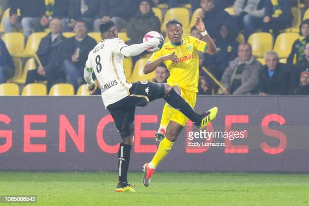 Anthony Limbombe of Nantes and Ismael Traore of Angers during the Ligue 1 match between Nantes and Angers at Stade de la Beaujoire on November 24...
