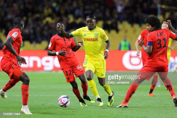 Anthony Limbombe of Nantes and Racine Coly of Nice during the Ligue 1 match between Nantes and Nice at Stade de la Beaujoire on September 25 2018 in...
