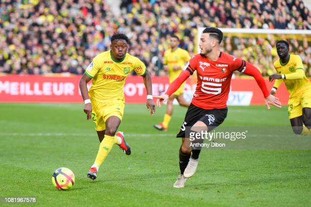 Anthony Limbombe of Nantes and Rami Bensebaini of Rennes during the Ligue 1 match between Nantes and Rennes at Stade de la Beaujoire on January 13...