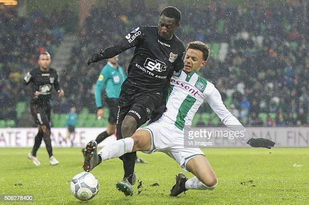 NEC Anthony Limbombe of NEC Desevio Payne of FC Groningen during the Dutch Eredivisie match between FC Groningen and NEC Nijmegen at Euroborg on...