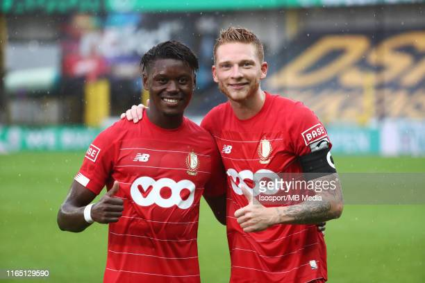 Anthony Limbombe of Standar and Renaud Emond of Standard celebrate after winning the Jupiler Pro League match between Cercle Brugge and Standard...