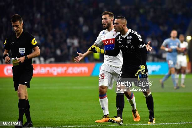 Anthony Lopes of Lyon protests after receiving a yellow card by the referee Bastien Benoit during the Ligue 1 match between Olympique Lyonnais and AS...