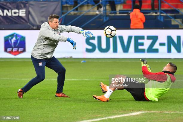 Anthony Lopes of Lyon warms up with Lyon goalkeeping coach Gregory Coupet before the French Cup match between Caen and Lyon at Stade Michel D'Ornano...