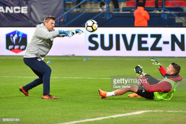 Anthony Lopes of Lyon warms up with Lyon goalkeeping coach Gregory Coupet during the French Cup match between Caen and Lyon at Stade Michel D'Ornano...