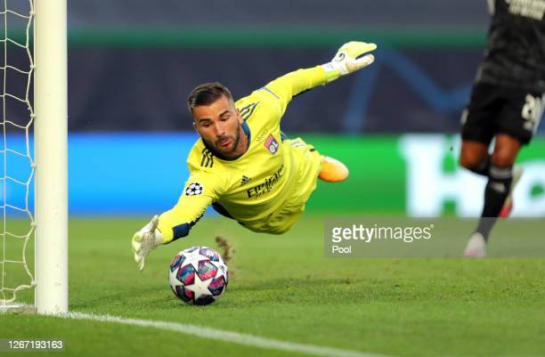 Anthony Lopes of Olympique Lyonnais saves a shot from Leon Goretzka of Bayern Munich during the UEFA Champions League Semi Final match between...