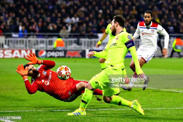 Anthony Lopes of Olympique Lyonnais saves a shot from Lionel Messi of FC Barcelona during the UEFA Champions League Round of 16 First Leg match...