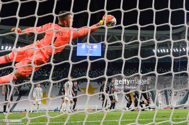 Anthony Lopes of Olympique Lyonnais stretches out to make a save on a free kick by Cristiano Ronaldo of Juventus FC during the UEFA Champions League...