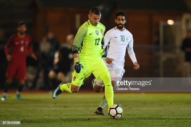 Anthony Lopes of Portugal competes for the ball with Alhaza Hazaa of Saudi Arabia during the International Friendly match between Portugal and Saudi...