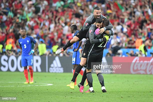 Anthony Lopes Rui Patricio and Eduardo of Portugal celebrate during the European Championship Final between Portugal and France at Stade de France on...