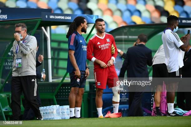 Anthony Lopes speaks to Jason Denayer of Olympique Lyon during the Olympique Lyonnais Training Session ahead of the UEFA Champions League match...