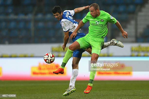 Anthony Losilla of Bochum and Frank Loening of Erzgebirge Aue go up for a header during the Second Bundesliga match between VfL Bochum and Erzgebirge...