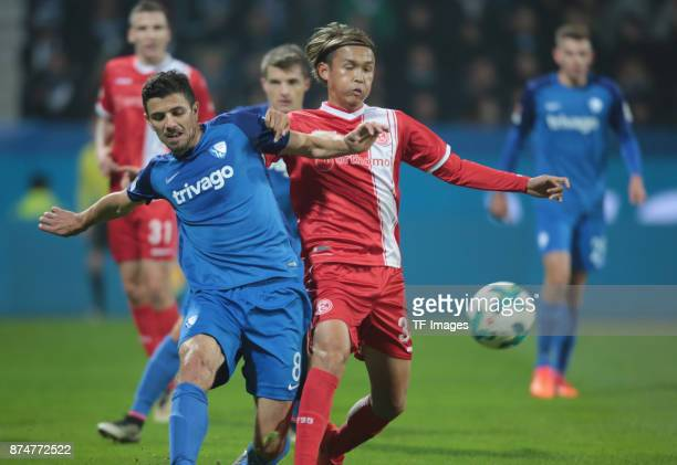 Anthony Losilla of Bochum and Takashi Usami of Duesseldorf battle for the ball during the Second Bundesliga match between VfL Bochum 1848 and Fortuna...