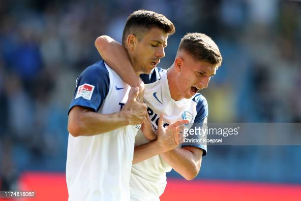 Anthony Losilla of Bochum celebrates the second goal with Vitaly Janelt of Bochum during the Second Bundesliga match between VfL Bochum 1848 and SG...