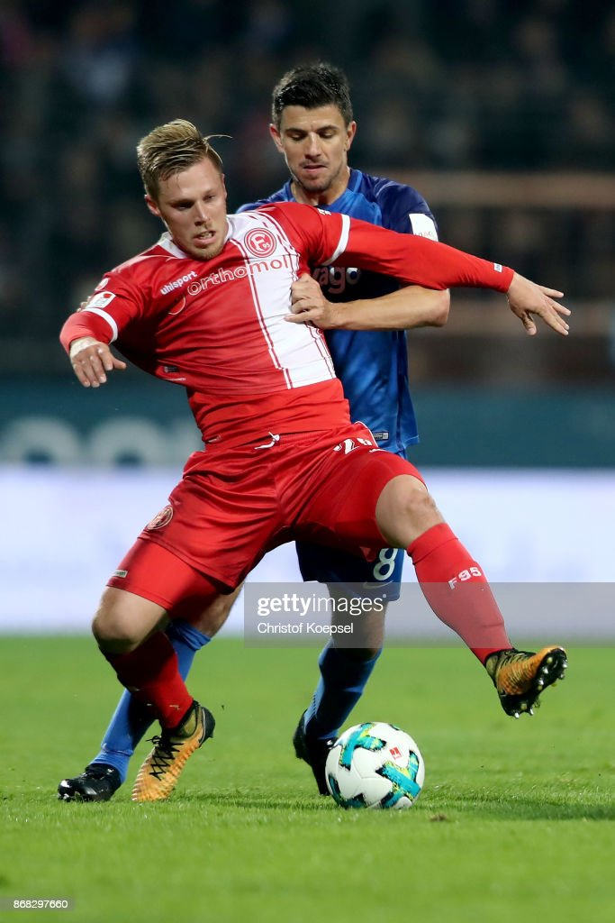 Anthony Losilla of Bochum (R) challenges Rouwen Hennings of Duesseldorf (L) during the Second Bundesliga match between VfL Bochum 1848 and Fortuna Duesseldorf at Vonovia Ruhrstadion on October 30, 2017 in Bochum, Germany.