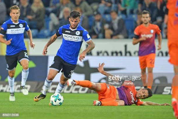 Anthony Losilla of Bochum tackles Keanu Staude of Bielefeld during the Second Bundesliga match between DSC Arminia Bielefeld and VfL Bochum 1848 at...