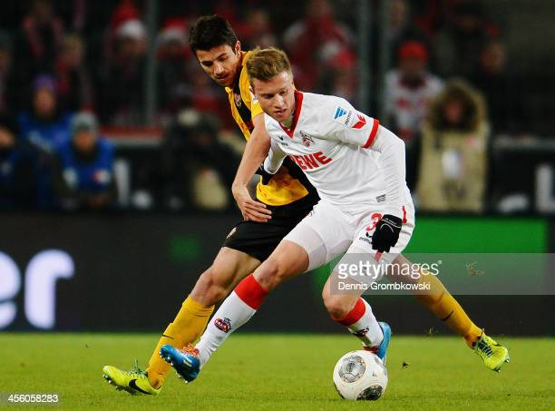 Anthony Losilla of Dynamo Dresden challenges Yannick Gerhardt of 1 FC Koeln during the Second Bundesliga match between 1 FC Koeln and Dynamo Dresden...