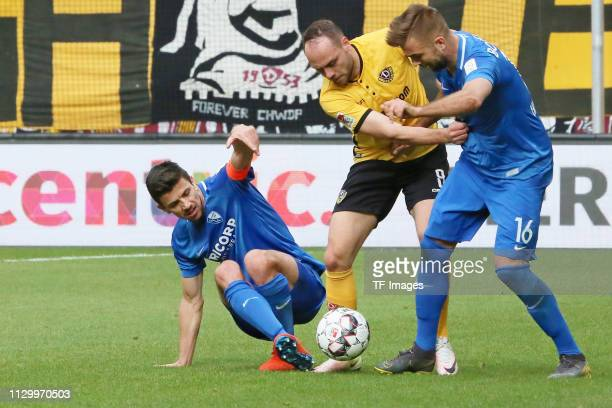Anthony Losilla of VfL Bochum 1848, Rico Benatelli of Dynamo Dresden and Lukas Hinterseer of VfL Bochum 1848 battle for the ball during the second...