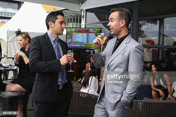 Anthony Lum and Jessie Emery share a drink inside the Little Sydney enclosure during the BMW Australian Derby at Royal Randwick Racecourse on April...