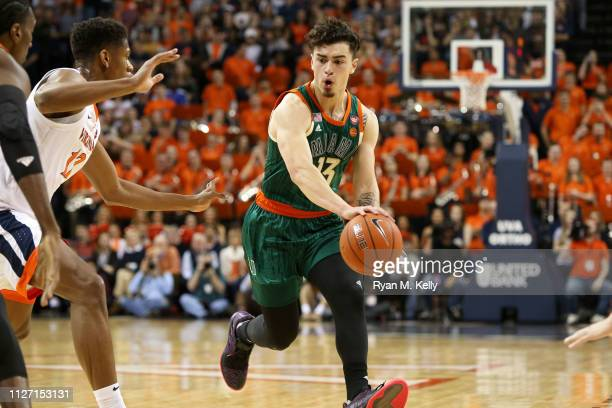 Anthony Mack of the Miami Hurricanes passes the ball in the first half during a game against the the Virginia Cavaliers at John Paul Jones Arena on...
