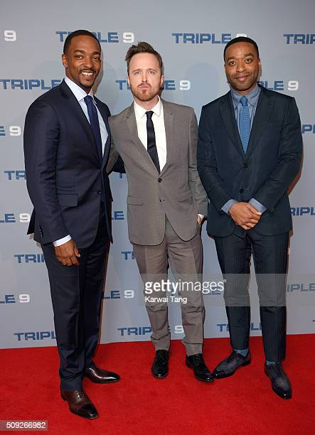 Anthony Mackie Aaron Paul and Chiwetel Ejiofor attend the Special Screening of 'Triple 9' at Ham Yard Hotel on February 9 2016 in London England