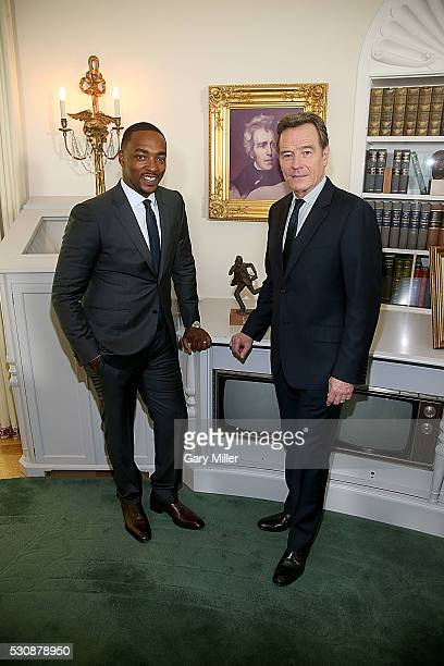Anthony Mackie and Bryan Cranston pose in the replica of the Oval Office before the Premiere Of HBO's 'All The Way' at the Lyndon Baines Johnson...