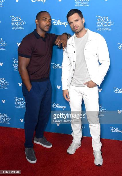 Anthony Mackie and Sebastian Stan attend D23 Disney showcase at Anaheim Convention Center on August 23 2019 in Anaheim California