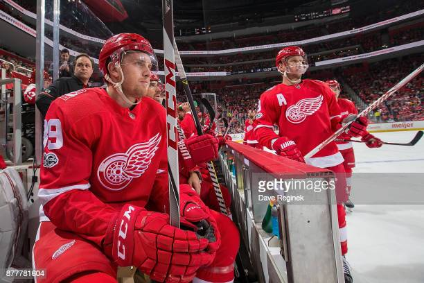 Anthony Mantha and Justin Abdelkader of the Detroit Red Wings looks on during a play stoppage from the bench against the Colorado Avalanche during an...