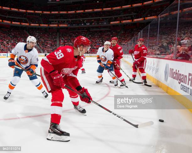 Anthony Mantha Jonathan Ericsson and Dylan Larkin of the Detroit Red Wings battle in the corner for the puck with Adam Pelech and Anthony Beauvillier...