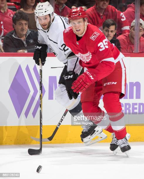 Anthony Mantha of the Detroit Red Wings battles along the boards with Derek Forbort of the Los Angeles Kings during an NHL game at Little Caesars...