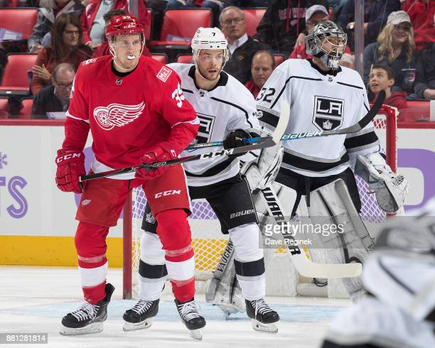 Anthony Mantha of the Detroit Red Wings battles for position with Oscar Fantenberg of the Los Angeles Kings in front of goaltender Jonathan Quick of...
