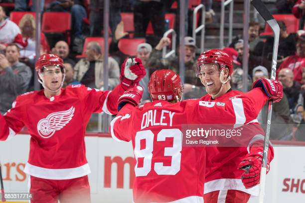 Anthony Mantha of the Detroit Red Wings celebrates his first period goal with teammates Trevor Daley and Dylan Larkin during an NHL game against the...