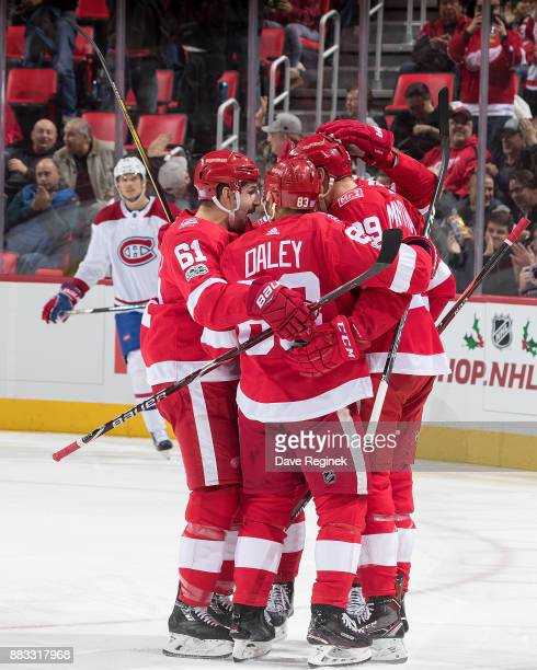 Anthony Mantha of the Detroit Red Wings celebrates his first period goal with teammates Trevor Daley and Xavier Ouellet during an NHL game against...
