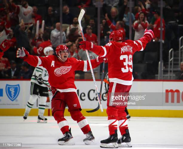 Anthony Mantha of the Detroit Red Wings celebrates his game winning and fourth goal of the game with Dylan Larkin while playing the Dallas Stars at...