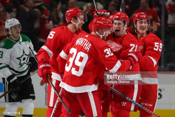 Anthony Mantha of the Detroit Red Wings celebrates his game winning and fourth goal of the game with Dylan Larkin Tyler Bertuzzi and Danny DeKeyser...