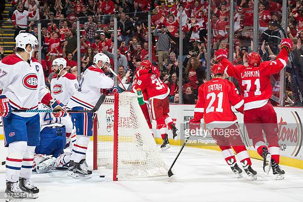 Anthony Mantha of the Detroit Red Wings celebrates his goal with teammates Tomas Tatar and Dylan Larkin during an NHL game against the Montreal...