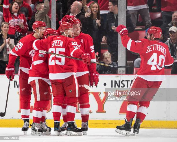 Anthony Mantha of the Detroit Red Wings celebrates his second period goal with teammates Danny DeKeyser Tomas Tatar Mike Green and Henrik Zetterberg...