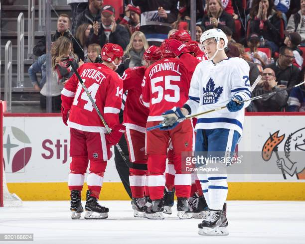 Anthony Mantha of the Detroit Red Wings celebrates his second period goal with teammates Gustav Nyquist and Niklas Kronwall as Travis Dermott of the...