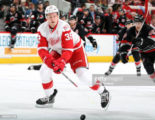 Anthony Mantha of the Detroit Red Wings collects a loose puck that leads to a breakaway during an NHL game against the Carolina Hurricanes on March...