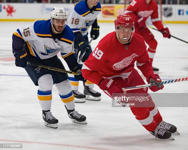 Anthony Mantha of the Detroit Red Wings follows the play in front of Robby Fabbri of the St Louis Blues during a preseason Kraft Hockeyville game at...
