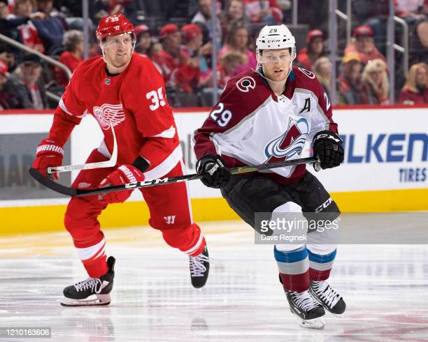 Anthony Mantha of the Detroit Red Wings follows the play next to Nathan MacKinnon of the Colorado Avalanche during an NHL game at Little Caesars...