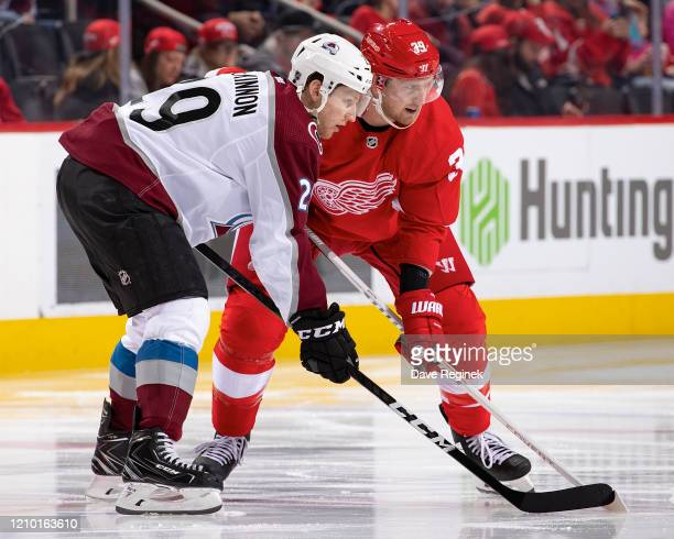 Anthony Mantha of the Detroit Red Wings gets set for the face-off next to Nathan MacKinnon of the Colorado Avalanche during an NHL game at Little...