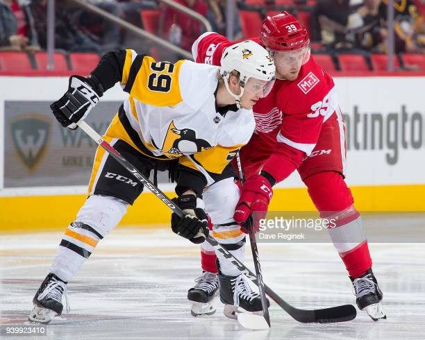 Anthony Mantha of the Detroit Red Wings gets set for the faceoff next to Jake Guentzel of the Pittsburgh Penguins during an NHL game at Little...