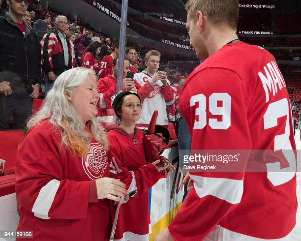 Anthony Mantha of the Detroit Red Wings greets season ticket holders following an NHL game against the New York Islanders at Little Caesars Arena on...