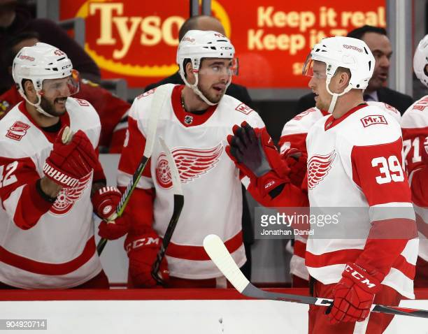 Anthony Mantha of the Detroit Red Wings is congratulated by teammates after scoring a third period goal against the Chicago Blackhawks at the United...