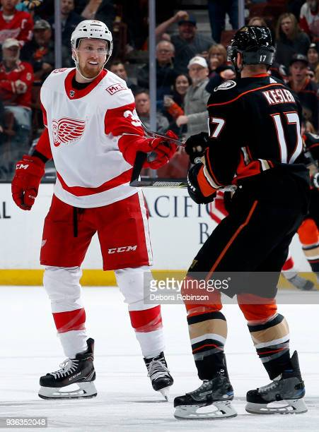Anthony Mantha of the Detroit Red Wings lines up for a fight against Ryan Kesler of the Anaheim Ducks during the game on March 16 2018 at Honda...