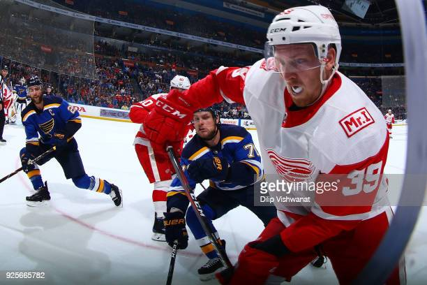 Anthony Mantha of the Detroit Red Wings looks to pass the puck against Vladimir Sobotka of the St Louis Blues at Scottrade Center on February 28 2018...