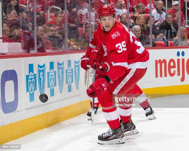 Anthony Mantha of the Detroit Red Wings passes the puck against the New York Islanders during an NHL game at Little Caesars Arena on April 7 2018 in...